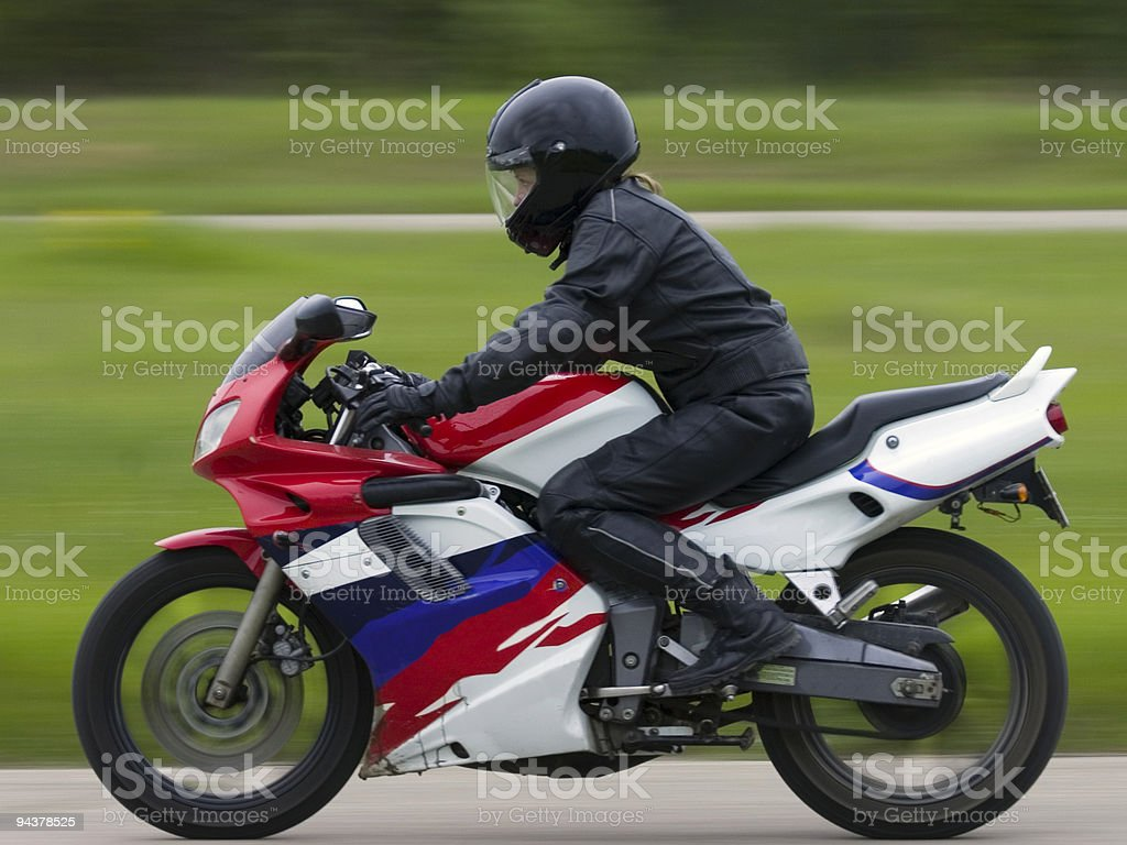 Girl on motorcycle stock photo