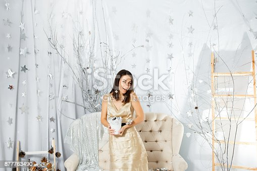 627933752istockphoto Girl on New Year party in light colors 877763490