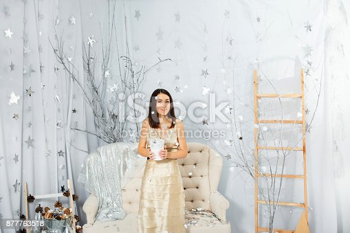 627933752istockphoto Girl on New Year party in light colors 877763518