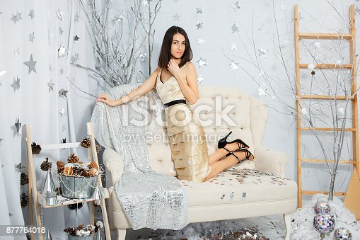 627933752istockphoto Girl on New Year party in light colors 877764018