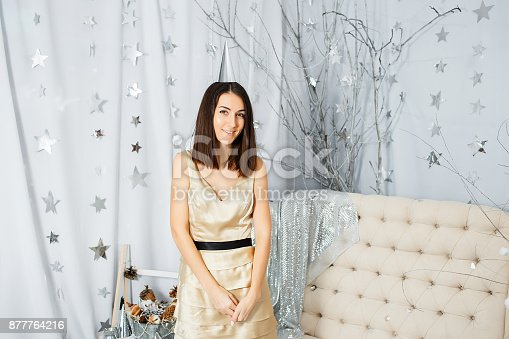 627933752istockphoto Girl on New Year party in light colors 877764216