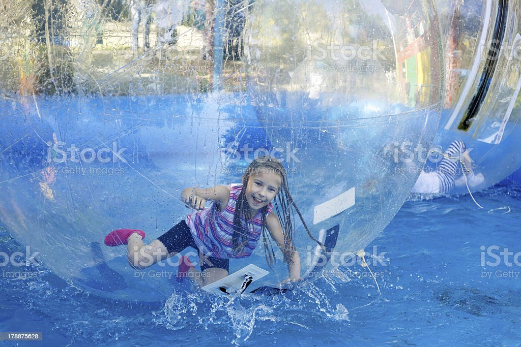 Girl on roller coaster zorbing stock photo
