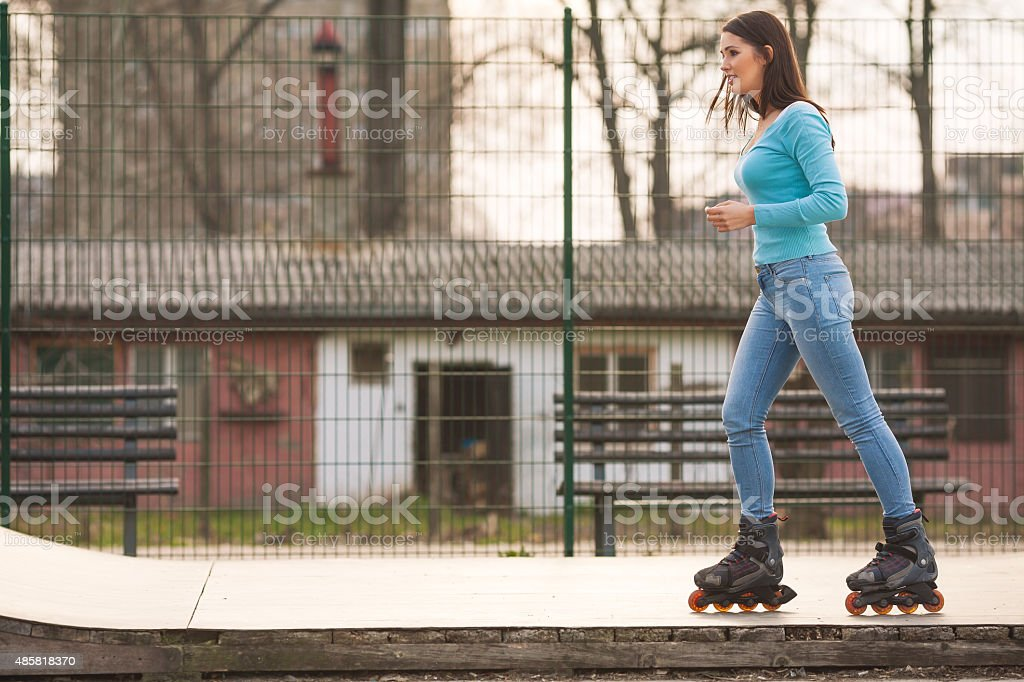 Girl on Rollerblades stock photo