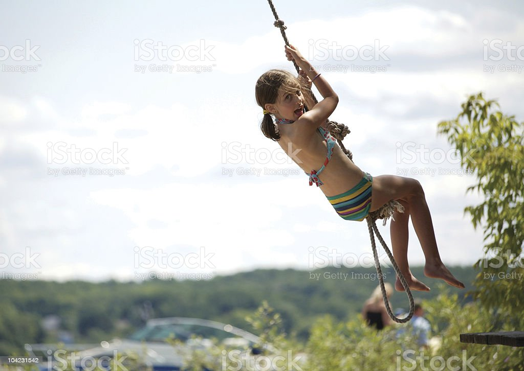 Girl on rope swing over the water stock photo more for Swing over water