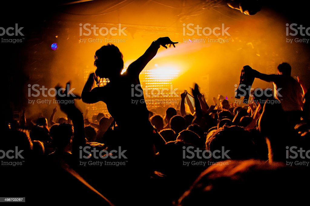Girl On Shoulders in Nightclub Party Silhouette stock photo