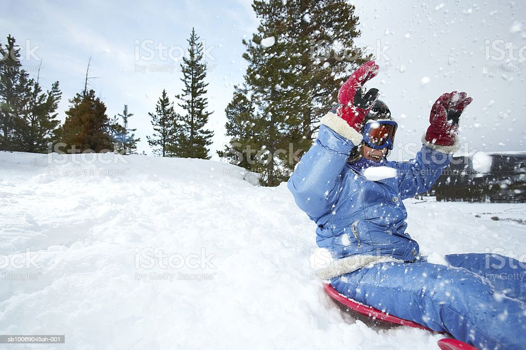Girl (8-9) on sled royalty-free stock photo