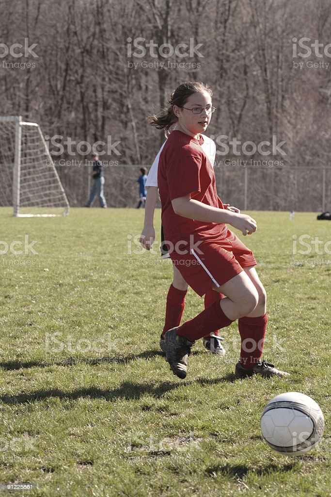 Girl on Soccer Field 19 royalty-free stock photo