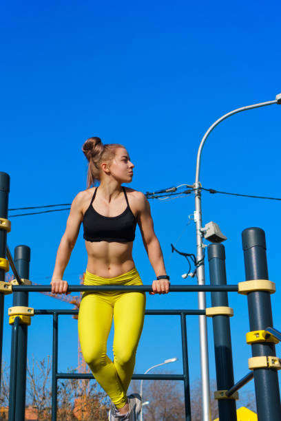 girl on street workout - horizontal bar stock photos and pictures
