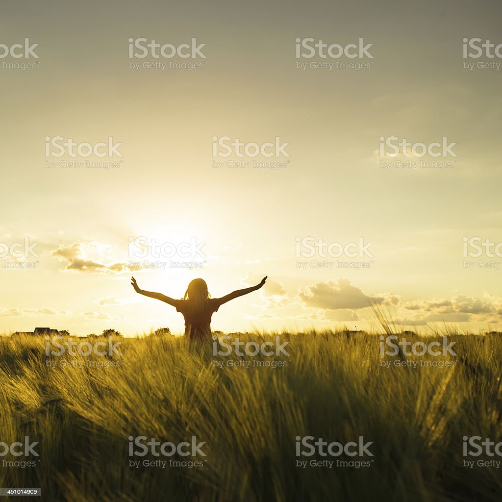 Girl on sunset stock photo