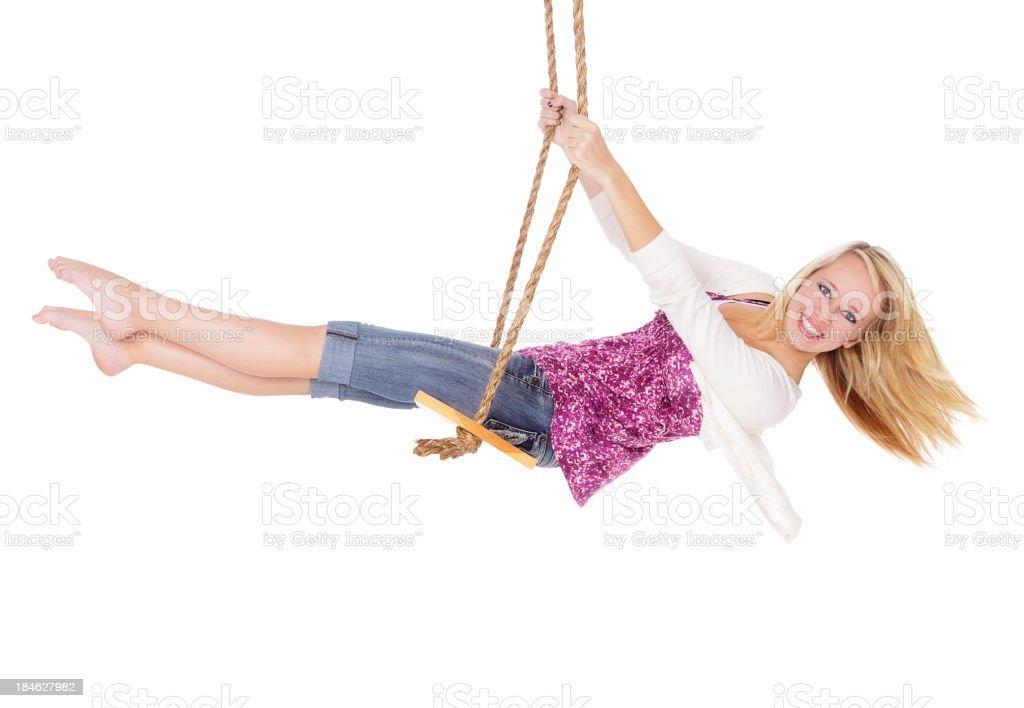 Девушка на качели стоковое фото