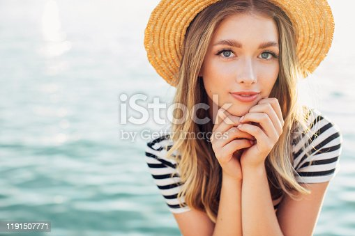 Girl on the background of the sea