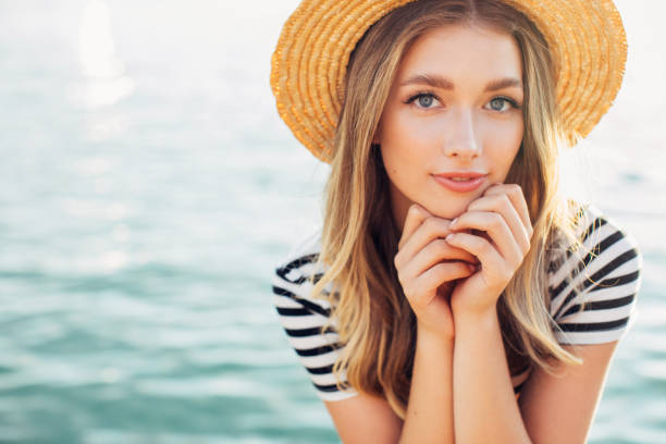 Girl on the background of the sea stock photo