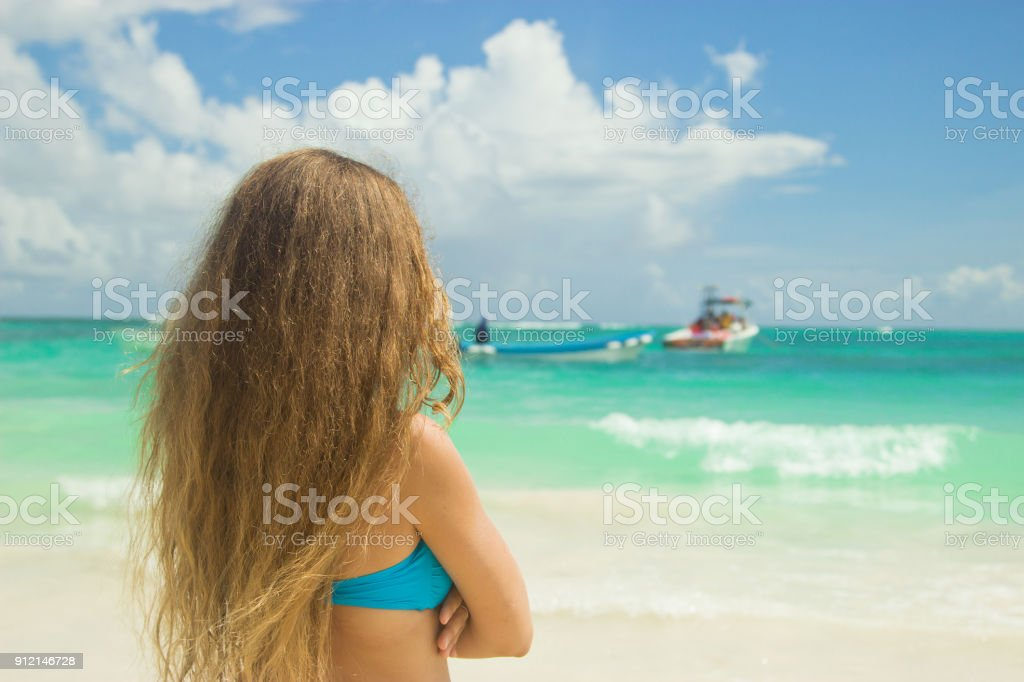 A girl on the beach in Punta Cana, Dominican Republic. stock photo