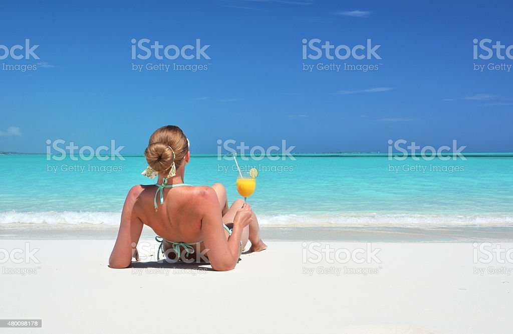 Girl on the beach of Exuma, Bahamas stock photo