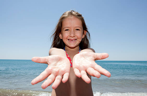 girl on the beach - little girls giving head stock photos and pictures