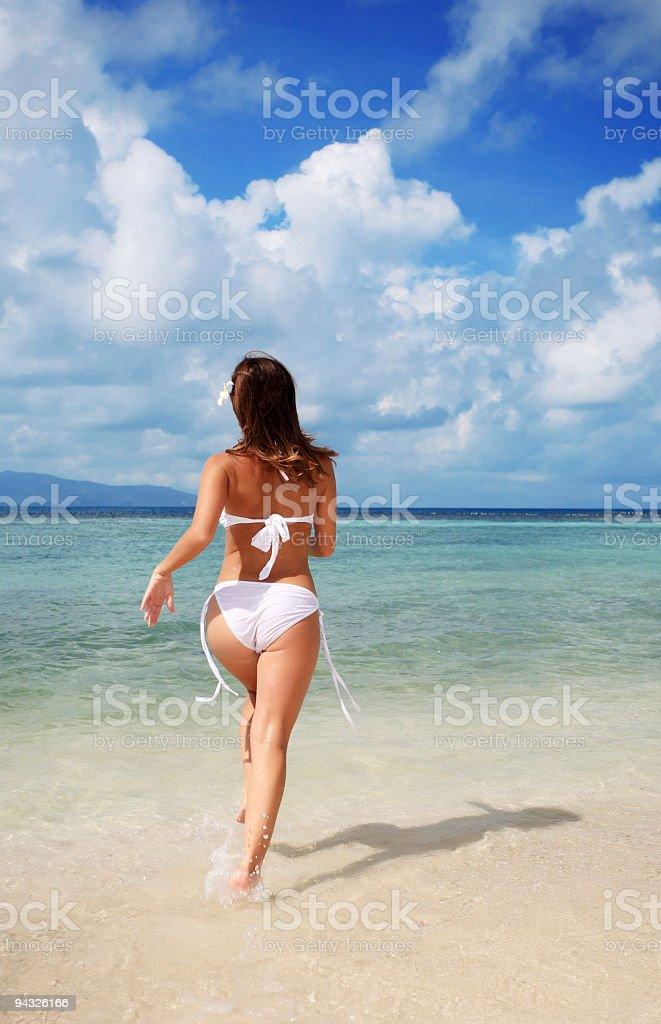 Girl on the beach. royalty-free stock photo