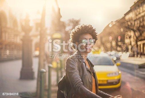624206636istockphoto Girl on the city 673494016