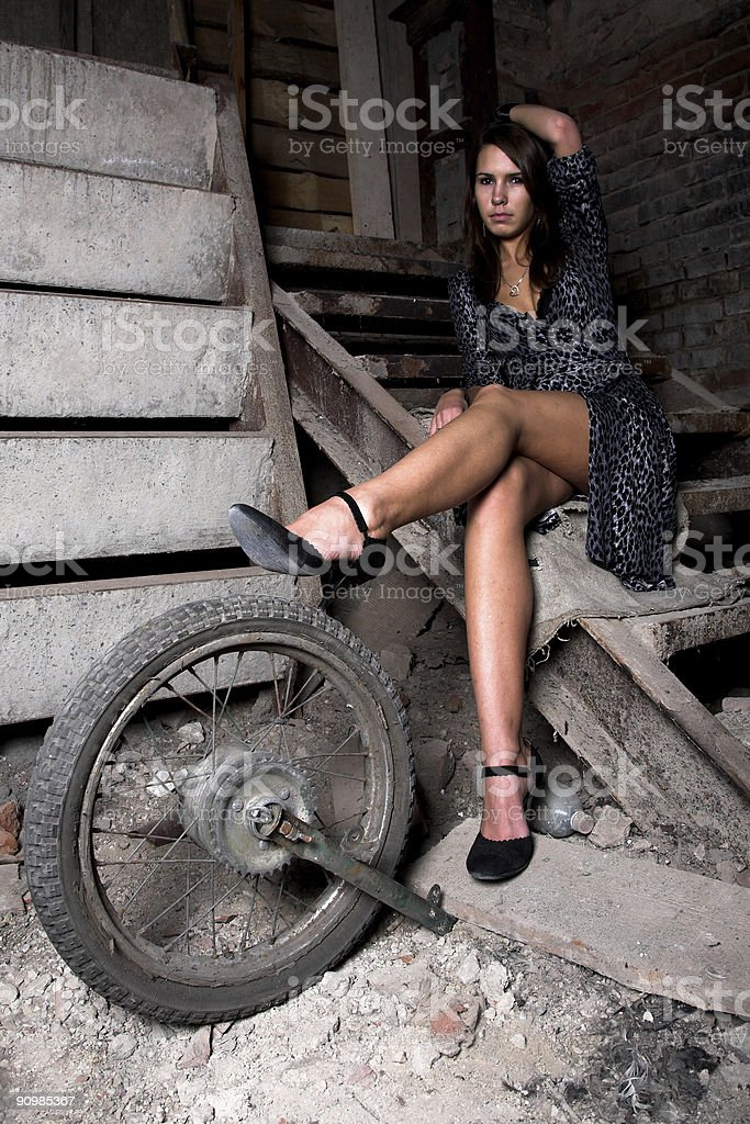 girl on the dark stairs royalty-free stock photo