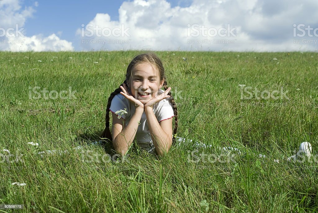 Girl on  the grass I royalty-free stock photo