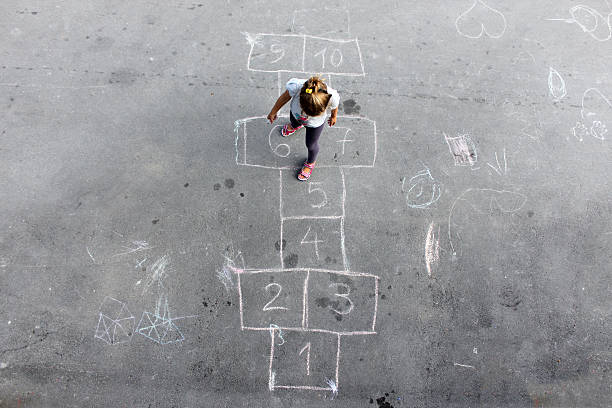 girl on the hopscotch - recess stock photos and pictures
