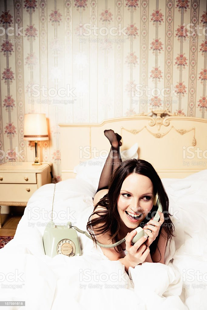 Girl on the Phone in Bed royalty-free stock photo