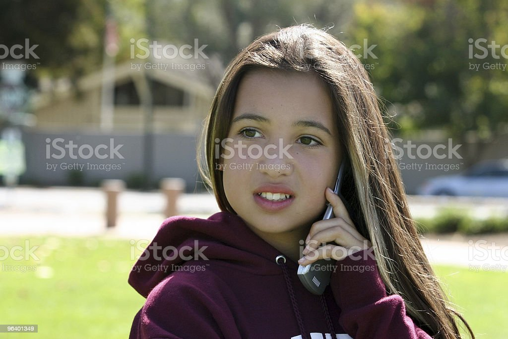 Girl on the phone - Royalty-free Animal Hair Stock Photo