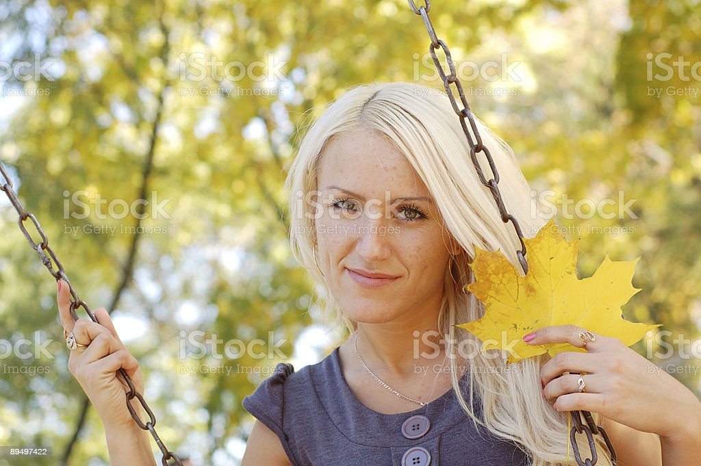 Girl on the seesaw royalty free stockfoto