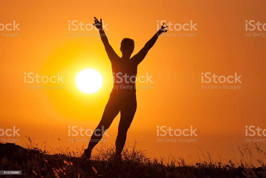 girl on the sunset background stock photo