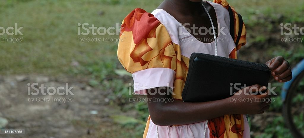 Girl on the way to church stock photo