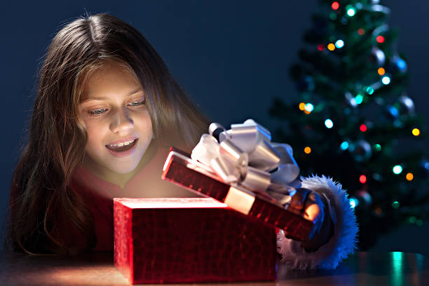 Girl open christmas box stock photo