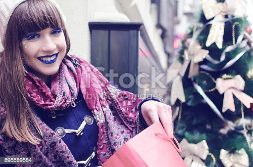 455111881istockphoto Girl open present for Christmas 895589584