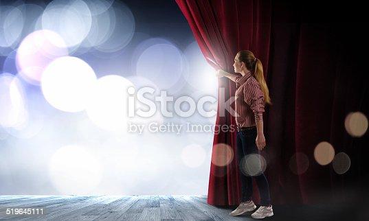 istock Girl opening curtain 519645111