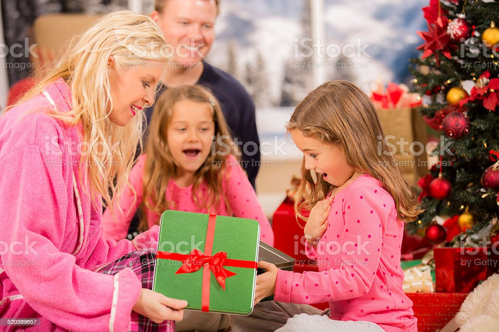 Girl Opens Christmas Present With Mom Tree Holiday Morning ...
