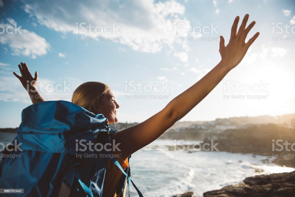 Girl opens her arms to the nature royalty-free stock photo