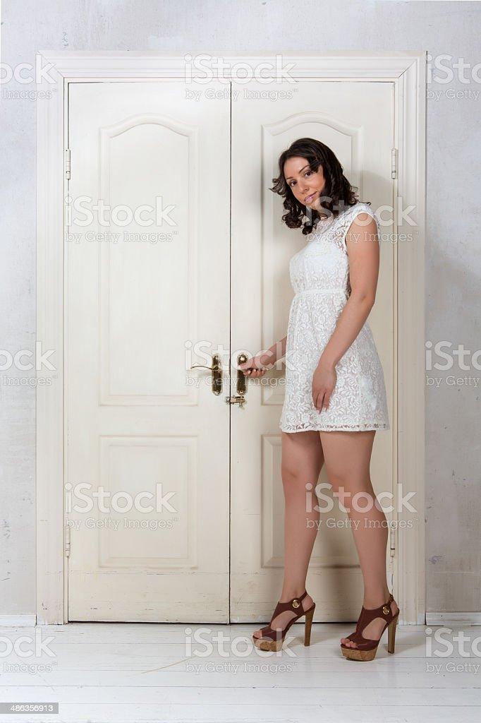 girl opens the door stock photo
