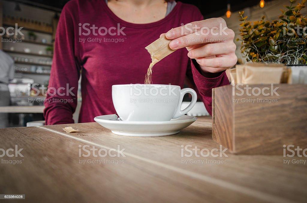 girl or woman chooses brown sugar - foto de acervo