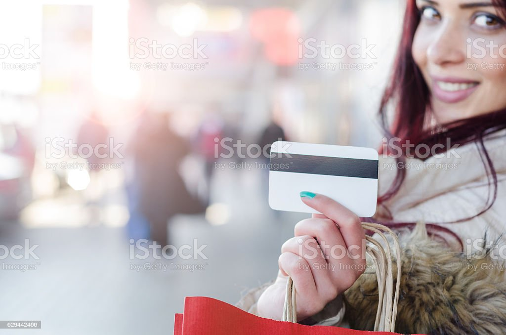 Girl or young woman going in shopping with bags stock photo