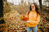 Girl out on a relaxing walk in a forest on a cold autumn day.