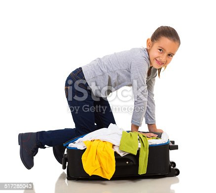 926982852 istock photo girl packing suitcase 517285043