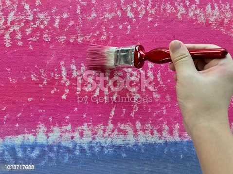 847999586 istock photo Girl painting acrylic color on canvas 1028717688