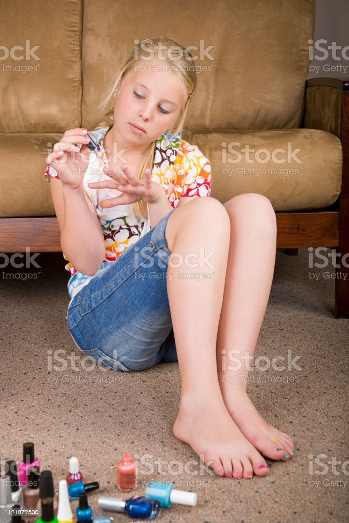 Girl Painting Her Nails stock photo