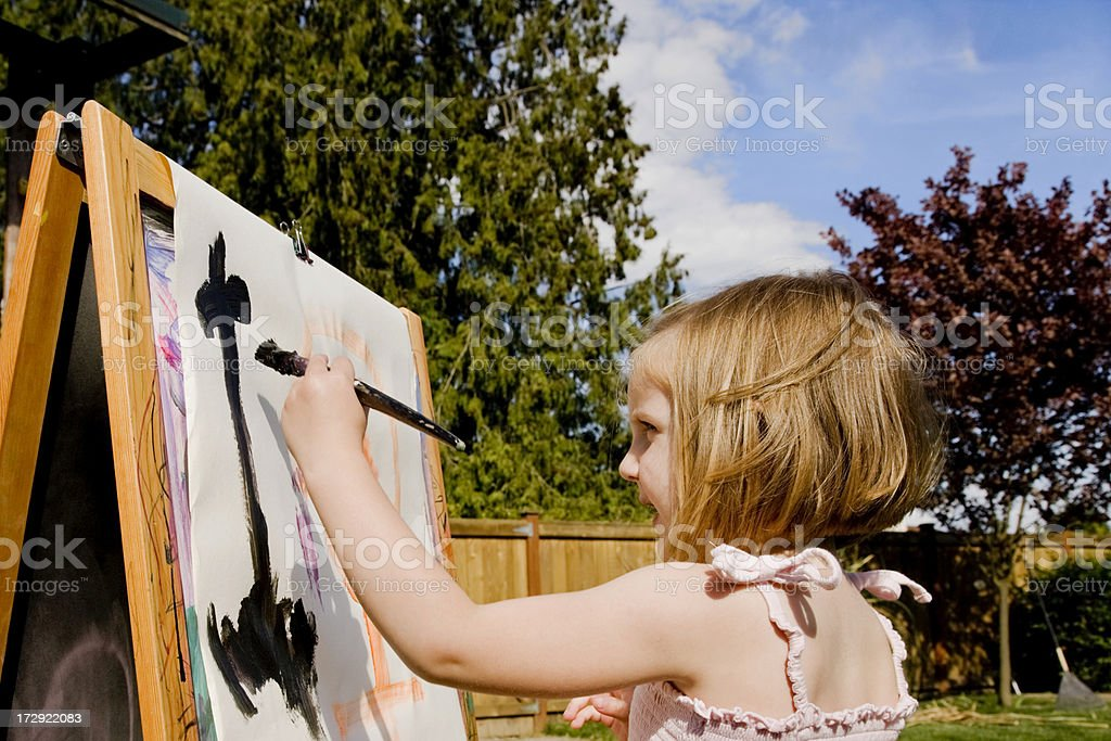 girl painting outdoors stock photo