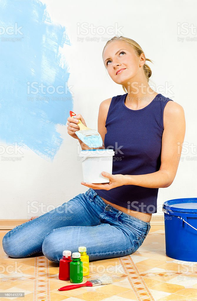 Girl painting the walls royalty-free stock photo
