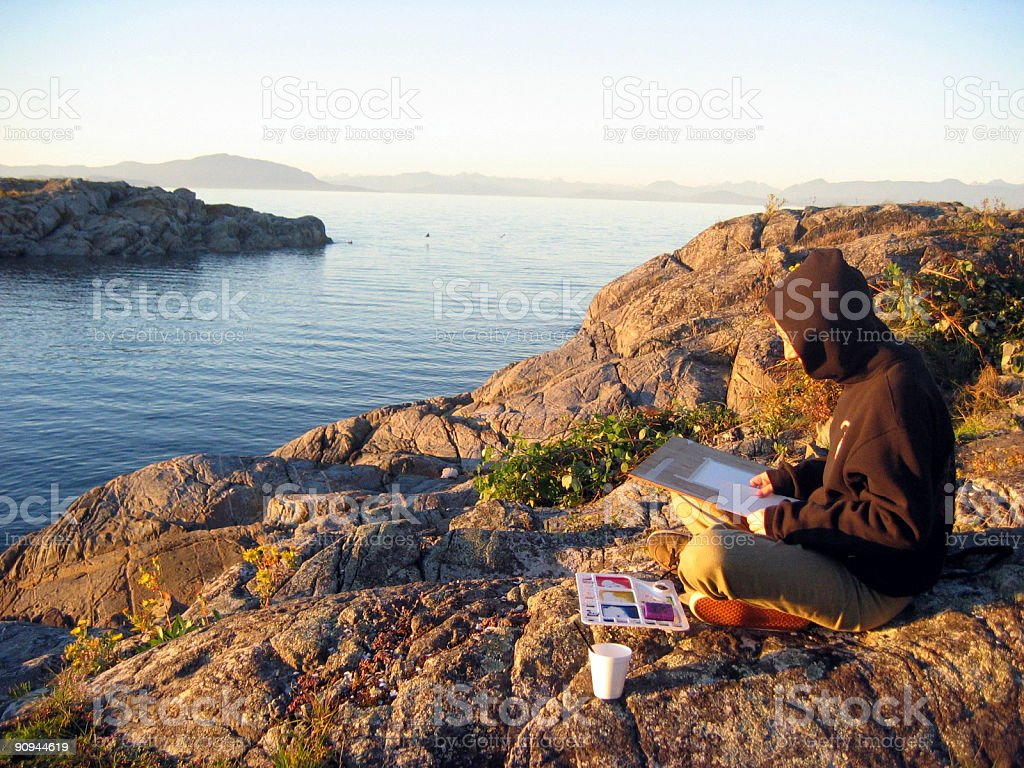 Girl Painting Watercolors on West Coast Shoreline stock photo