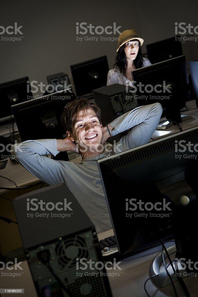 Girl Peeking at Boy in Computer Lab royalty-free stock photo
