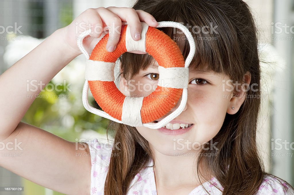 Girl peering through inflatable. royalty-free stock photo