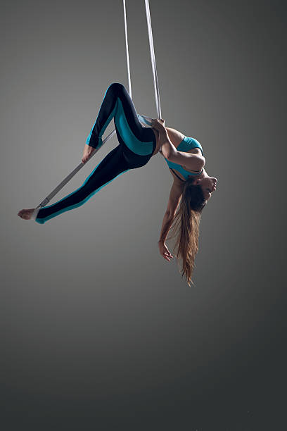 Girl performing aerial ribbons straps stock photo