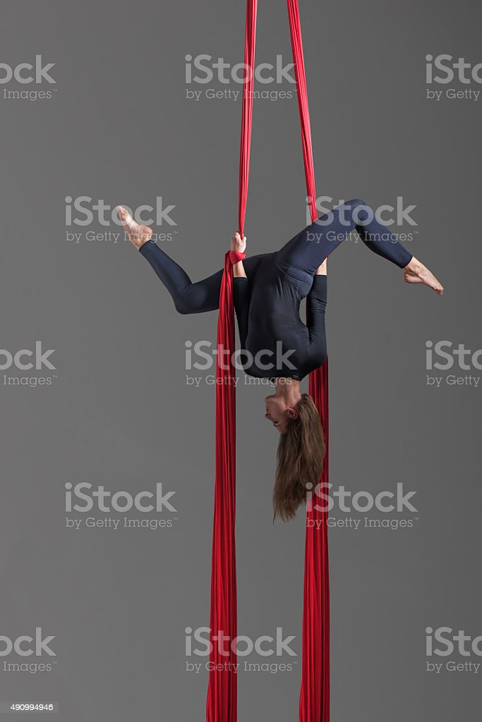 Girl performing aerial silk dance stock photo
