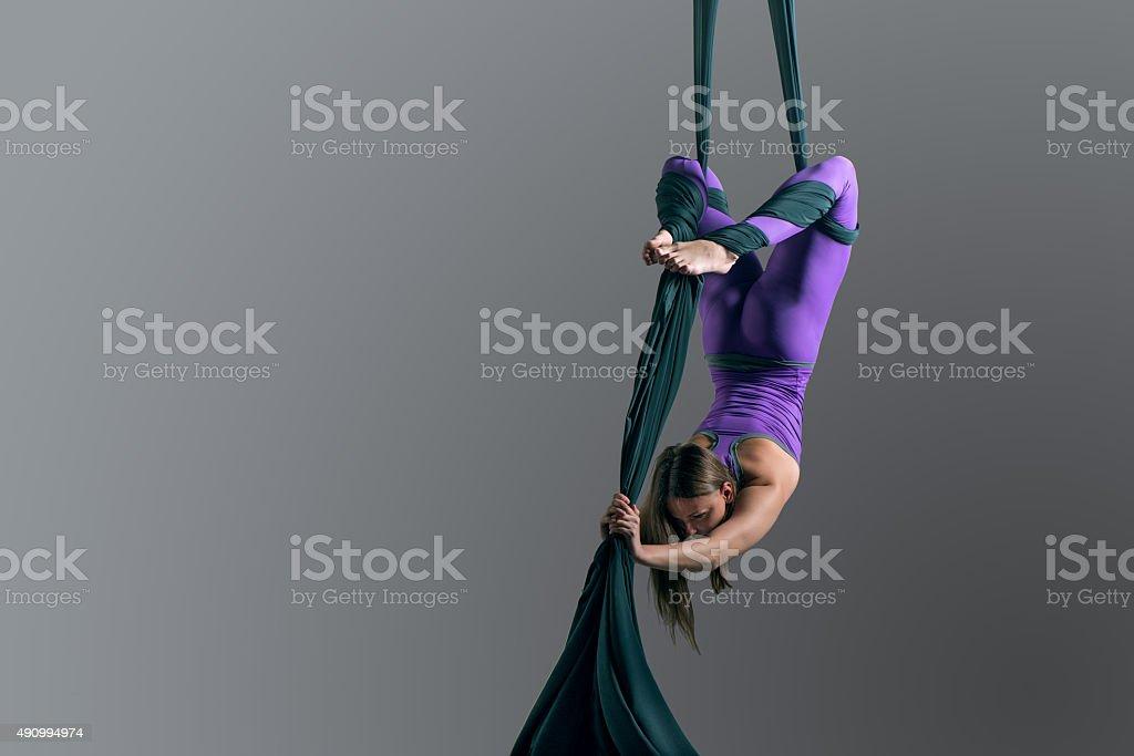Girl performing aerial silk dance stock photo