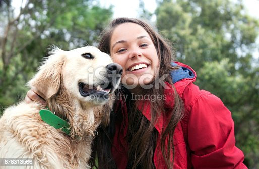 istock Girl petting the dog 676313566